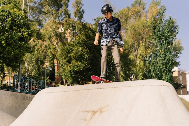 Skater boy with helmet Free Photo