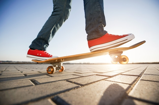 Skater riding a skateboard. view of a person riding on his skate wearing casual clothes Premium Photo