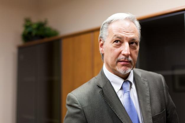 Skeptical businessman in his office Premium Photo