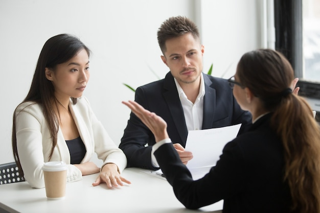 Skeptical diverse hr managers interviewing female applicant, bad first impression Free Photo