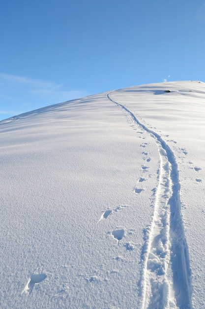 Ski path on mountain, winter landscape snow in the alps Premium Photo