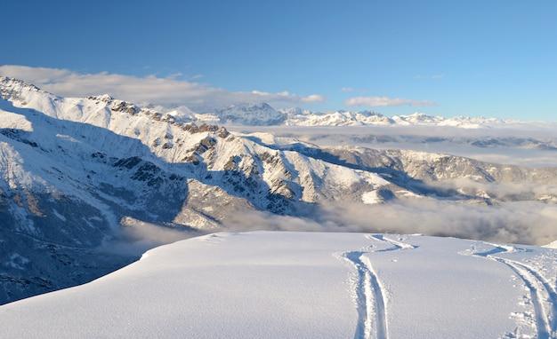 Ski path in powder snow, winter landscape in the alps Premium Photo