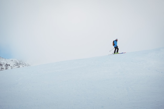 Skier skiing on snowy mountains Free Photo