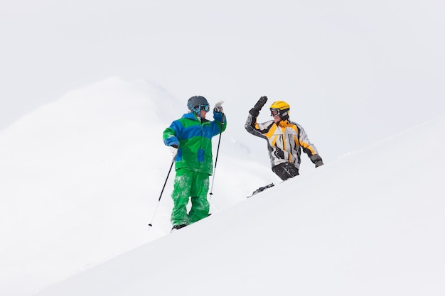 Skier and snowboarder in the snow Premium Photo
