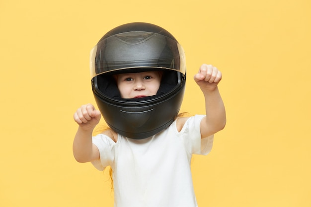 Skillful experienced little girl in safety motorcycle helmet Free Photo