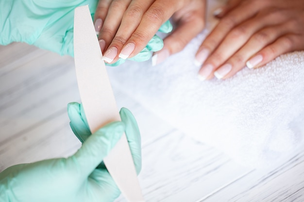 Skillful master of manicure holding file in her hands while working in her beauty salon Premium Photo