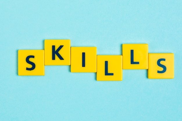 Skills word on scrabble tiles Free Photo