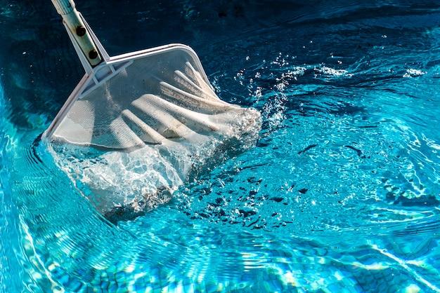 Skimmer rake in a pool. Premium Photo