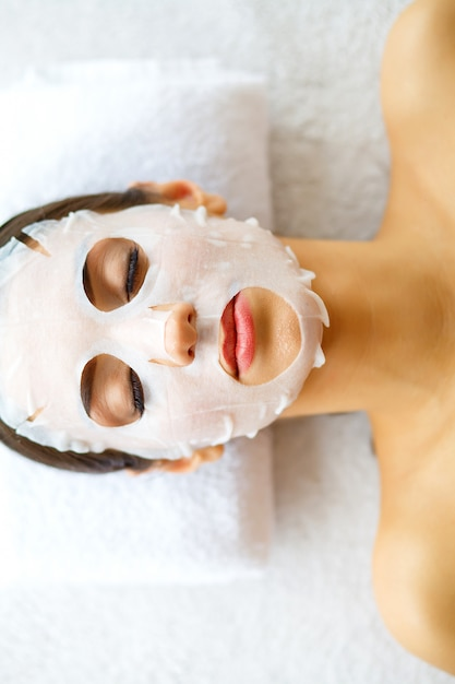Skin and care. beautiful woman lying with face mask. Premium Photo