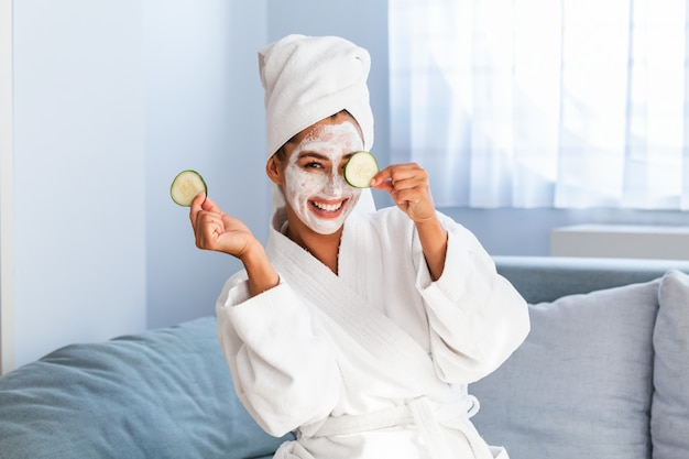 Skin care and beauty treatments with mask on her face Premium Photo