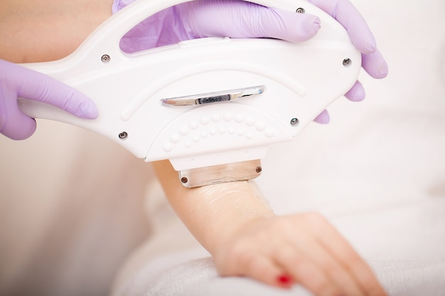 Skin care. hands laser epilation and cosmetology. hair removal cosmetology procedure. Premium Photo