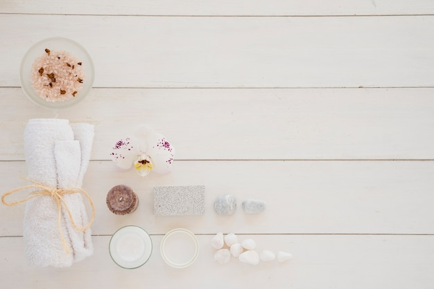 Skin care products and flower of white orchids Free Photo