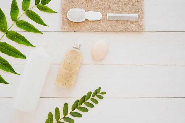 Skin care tools on desk with green leaves Free Photo