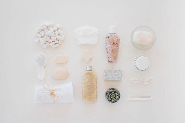 Skin care tools on white table Free Photo