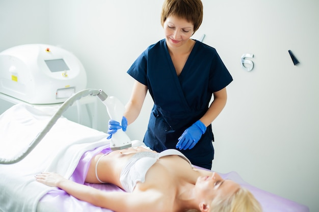 Skin care. woman is in the process at the clinic lipomassage. Premium Photo