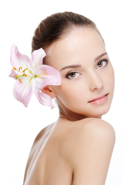 Skincare of young beautiful woman face Free Photo