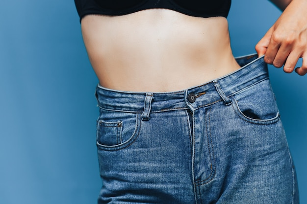 Skinny woman body with loose pants jeans Premium Photo