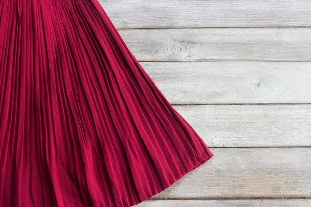 Skirt on wood table Premium Photo