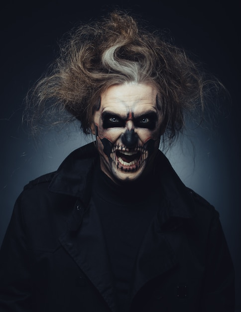 Skull makeup portrait of young man Free Photo