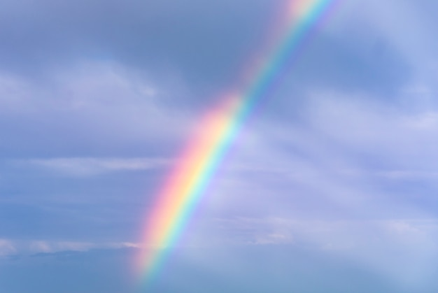 Sky background with rainbow after storm Premium Photo