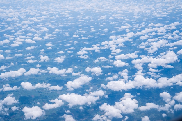 Sky clouds cape from aerial airplane shot of blue clouds. view flying above mountain Premium Photo