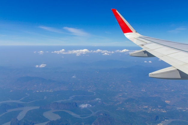 Sky wings and white clouds flying over phuket, thailand Premium Photo