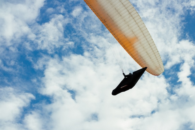 Skydiver in the sky among the clouds Premium Photo