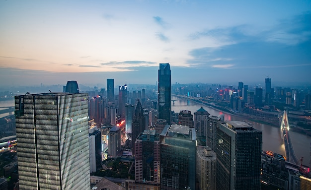 Skyline and landscape of chongqing at riverbank during sunrise. Free Photo