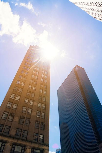 Skyscrapers from below cityscape in sunny day Free Photo