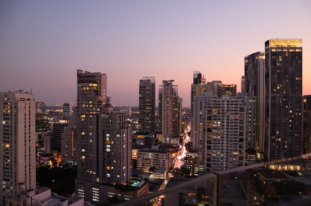 Skyscrapers view of bangkok downtown after the sunset as seen from rooftop terrace Premium Photo