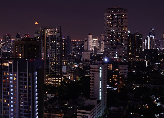 Skyscrapers view of bangkok downtown on the bright full moon night Premium Photo