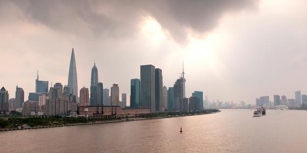 Skyscrapers at the waterfront, huangpu river, pudong, shanghai, china Premium Photo
