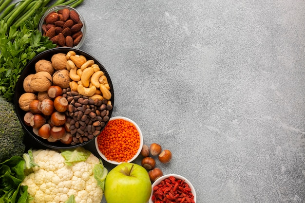 Slate background with copy space and vegetables Free Photo