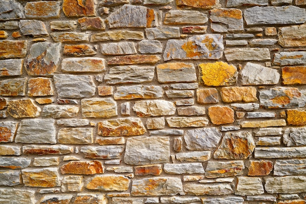 Slate stone masonry stone wall in andorra Premium Photo
