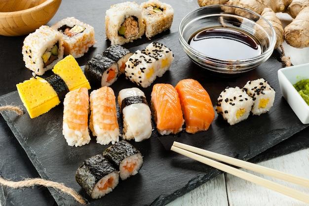 Slate tray of assorted sushi Premium Photo