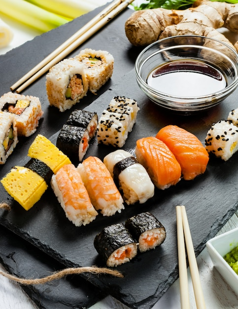 Slate tray of assorted sushi Premium Photo