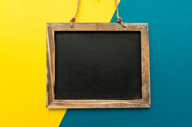 Slate on yellow and blue background Free Photo