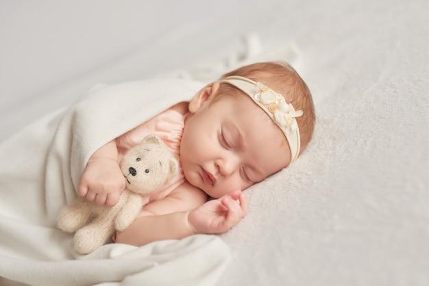 Sleeping baby 3 months on a light Premium Photo