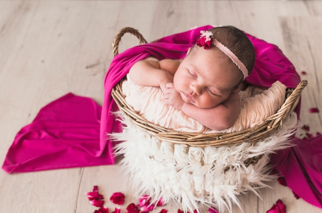 Sleeping tender baby under pink blanket Free Photo