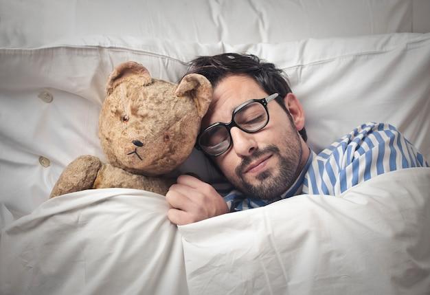 Sleeping with a teddy bear Premium Photo