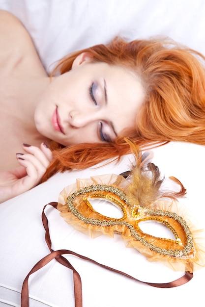 Sleeping woman near carnival mask. Premium Photo