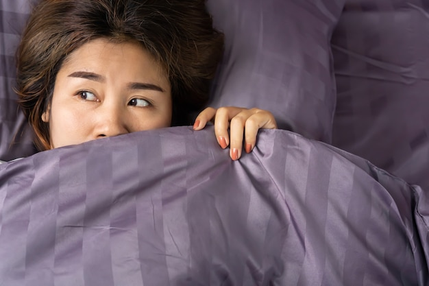 Sleepless asian woman insomnia  in bed Premium Photo