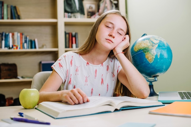 Sleepy student at book Free Photo