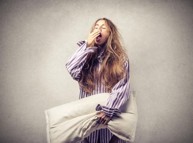 Sleepy woman with a pillow Premium Photo
