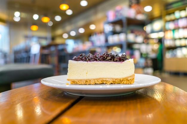 Slice of blueberry cheesecake Free Photo