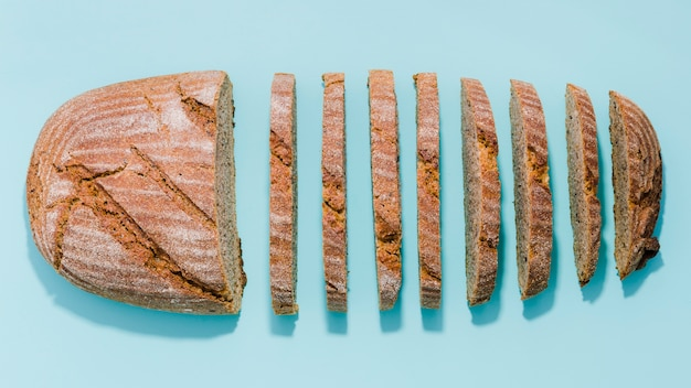 Slice of bread with color background Premium Photo