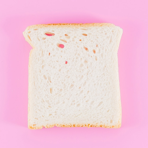 Slice of bread with color background Free Photo