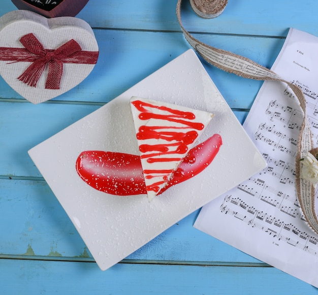 A slice of cake with cocoa powder. Free Photo
