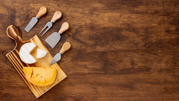 Slice of cheese with accessories and copy space Free Photo