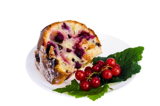 Slice of fruit cake with isolated on white background Premium Photo